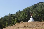 stock photo of teepee  - White teepee at the top of the hill - JPG