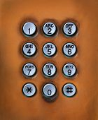 image of dial pad  - file of dial number button on old used public telephone - JPG