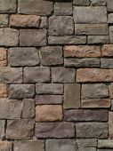 stock photo of mortar-joint  - stone retaining wall below patio - JPG