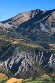 foto of mudslide  - Beautiful landscape with mudslides in the bottom part located in the Southern French Alps in The Alpes - JPG