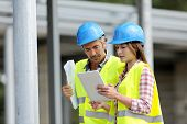 picture of real-estate-team  - Construction people using electronic tablet on site - JPG