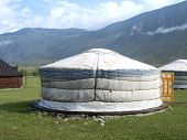 stock photo of yurt  - Traditional Altai yurt in the mountains with sky background - JPG