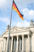 German Flag With A Reichstag On Background