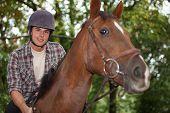 Teen riding a horse