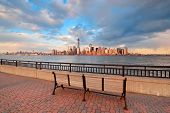 stock photo of freedom tower  - Downtown Manhattan skyline at sunset over Hudson River in New York City - JPG