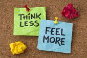 think less, feel more - words of wisdom - handwriting on colorful sticky notes