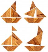 foto of tangram  - four abstract pictures of sailing boats built from seven tangram wooden pieces - JPG