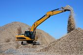 stock photo of dredge  - Dredge loads a rubble against the blue sky - JPG
