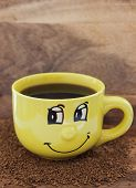 Yellow Mug With Smile And Coffee On The Table With A Instant Coffee Granules