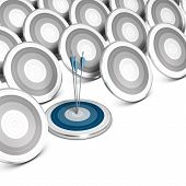 stock photo of niche  - Many grey targets and one blue target with three arrows hitting the center conceptual image sitable for market audience targeting and positioning strategy - JPG