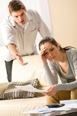 Worried arguing couple has financial crisis
