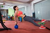 Crossfit fitness woman push ups with Kettlebell rear pushup exercise
