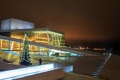 OSLO, NORWAY - DECEMBER 31: National Oslo Opera House shines at night on December 31, 2012. Oslo Opera House was opened on April 12, 2008 in Oslo, Norway