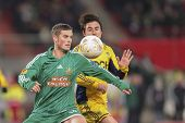 VIENNA, AUSTRIA - DECEMBER 6 Christopher Drazan (#19 Rapid) and Willian (#86 Metalist) fight for the