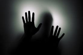 pic of paranormal  - Man behind the glass illuminated from behind - JPG