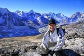 Hiker in front of the Khumbu Valley with the Himalayan Mountain Range and the outstanding Ama Dablam