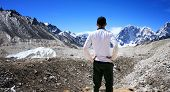 Rear View of Hiker standing in the Khumbu Valley with the Himalayan Mountain Range in background nea