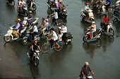 Crowd Of People Ride Motorcycle In Rush Hour