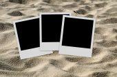 Empty Photo Frames  On Sand Background