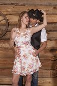 picture of she-male  - A western couple is standing together and she is holding his hat - JPG