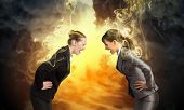 Image of two businesswomen in anger shouting at each other