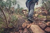 foto of survival  - Adventure man hiking wilderness mountain with backpack - JPG