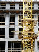Highrise building under construction with yellow jib crane
