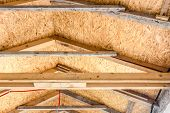 stock photo of glass-wool  - The roof of new house is being installed with environmentally friendly and energy efficient thermal insulation - JPG