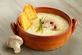 stock photo of champignons  - champignon mushroom soup with chives and croutons - JPG