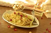 Whole grain spaghetti with cabbage pistachios and pomegranate