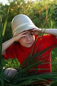 Boy explorer in a Pith helmet