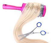 Long blond hair with hairbrush and scissors isolated on white