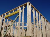 House Frame under Construction over Deep Blue Sky