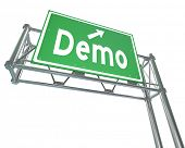 Demo word and arrow on a green freeway or highway road sign directing you to a product or service de