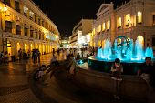 MACAU, CHINA - OCTOBER 31, 2012: Tourists visit the Historic Center of Macau - Senado Square. Histor