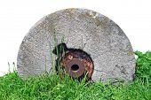 Old millstone on white background (isolated).