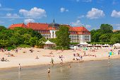 SOPOT, POLAND - 7 JUNE: People on the beach of Sopot at the Grand Hotel on 7 June 2014. Grand hotel
