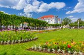 SOPOT, POLAND - 7 JUNE: Square with beautiful gardens at the Sopot Molo on 7 June 2014. Sopot is major health and tourist resort destination and has the longest wooden pier in Europe.