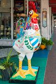 MIAMI,USA - MAY 19,2014 : Symbolic rooster sculpture representing the cuban american community at Calle Ocho , the focal point of the cuban community in Little Havana