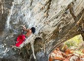 KRABI, THAILAND - MARCH 14, 2014: Rock climbers climbing on Railay beach in Krabi, Thailand. Railay