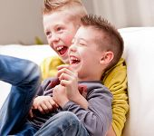picture of tickling  - two little boys maybe friends or brothers two little boys laughing about tickling - JPG