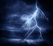 stock photo of striking  - A lightning strike on the cloudy sky - JPG