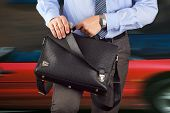 Businessman Holding And Opening  A  Leather Briefcase