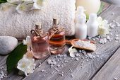 stock photo of jasmine  - Spa composition with jasmine flowers on table close - JPG