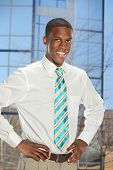 African American businessman with hands on hips inside office building