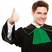 Law. Man Lawyer In Polish Gown Showing Thumb Up