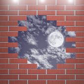Moon in the night sky with hole in the brick wall room.