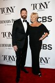 NEW YORK-JUNE 8: Actor Hugh Jackman (L) and wife  Deborra-Lee Furness attend American Theatre Wing's 68th Annual Tony Awards at Radio City Music Hall on June 8, 2014 in New York City.