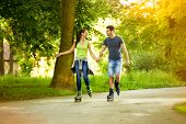 Young couple having recreation on rollerblades