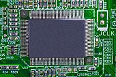 pic of informatics  - Green electronic circuit board with processor component - JPG